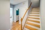 Foyer stairs storage closet powder room