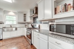 Kitchen remodeled in 2016 features white cabinets
