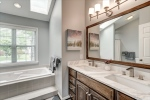Stunning owners bath features dual sinks