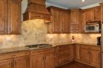 Custom cabinetry  gleaming granite are stunning!