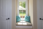 Mudroom offers sunny window seat!