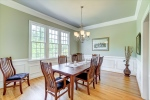 Spacious dining room with chair rail wainscoting
