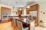 Gourmet kitchen with cherry cabinets and granite.