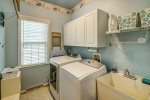 Laundry room with storage and sink