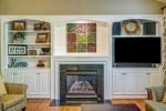 Gas fireplace flanked by built-in cabinets