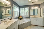 Owners bathroom features dual vanities