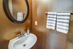 Powder room on main level features pedestal sink