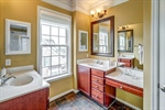 Owners bathroom with two vanities and prep area