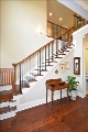 Wooden staircase with wrought iron railing