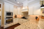 Granite counters and a gas cooktop
