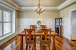 Dining room with tray ceiling and swinging door