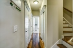 Hall from kitchen leads to laundry room and garage