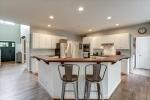 Gourmet kitchen features Ipe wood bar top