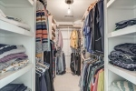 Owners suite features custom walk in closet