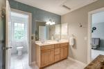 Hall bath features unique tiling