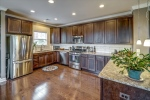 Gourmet kitchen with espresso cabinets and granite