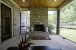 Wood burning fireplace on the screened porch