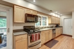 Bright kitchen with maple cabinetry