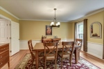 Formal dining room with chair rail and wainscoting
