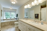 Completely remodeled owners bath w dual vanities