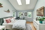 Owners suite with skylights and hardwoods