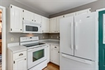 White electric appliances and cabinets gleam