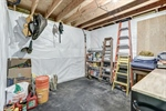 Unfinished storage area in basement
