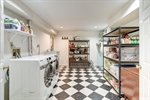 Laundry room and storage in basement