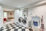 Laundry room opens to playroom