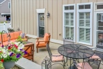 Dining room opens to bluestone patio w knee wall