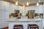 Kitchen features granite counters breakfast bar