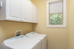 Laundry room with cabinetry for storage