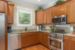 Shaker style cherry cabinetry w granite counters
