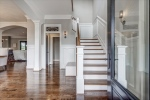Grand foyer with new espresso hardwood floors.