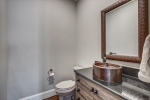 Powder room features copper sink