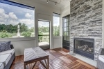 Screened porch with dual sided stone fireplace