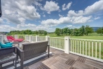Entertain or relax on deck overlooking golf course