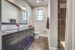 Hall bathroom with double vanities