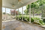 Shady flagstone screened porch for outdoor living