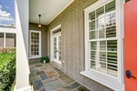 Side porch with flagstone makes a statement