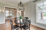 Dining room with transom arches holds a crowd