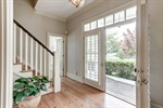 Double doors open to heart of pine floors in foyer