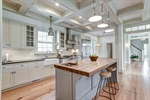 Chefs kitchen with coffered ceiling grand island!
