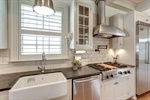 Farmhouse sink and tile backsplash