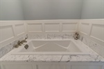 Soaking tub with marble and wainscoting