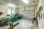 Spacious two-car garage with ramp and storage