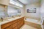 Owners bathroom with double sinks and soaking tub