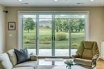 Wide sliding doors offer stunning views