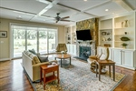Great room features coffered ceiling