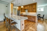Gourmet kitchen with shining granite counters